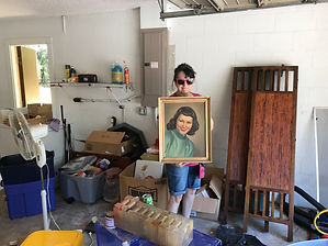 woman standing in clutter being removed by Action junk removal