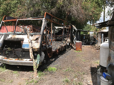 action junk removal removes a fire damage rv in Tampa Florida