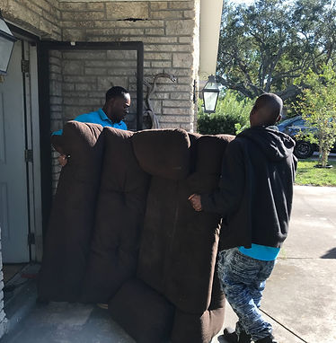 Action Junk Removal workers carrying sofa through front dorwoay +sofa +Removal
