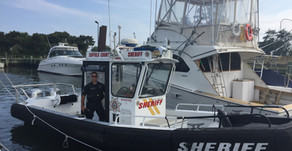 DEPUTY SHERIFFS RESCUE TWO SMALL CHILDREN ADRIFT ON RAFT IN PECONIC BAY