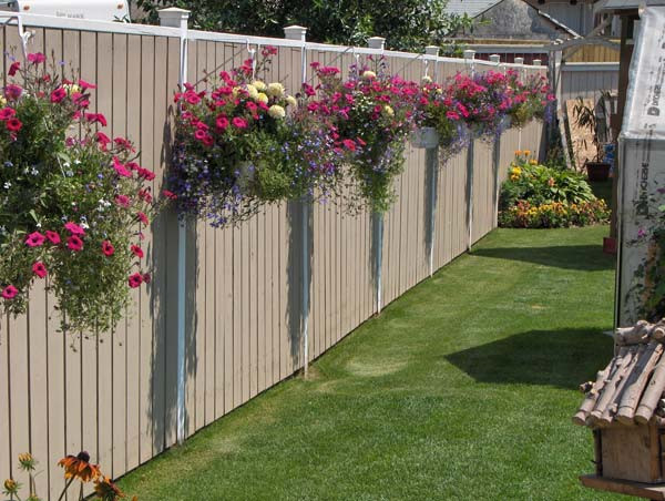 Hanging flower pots from vinyl wood aluminum fence summer time yard decorations
