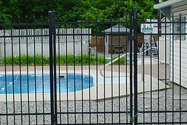 Aluminum Metal Iron Flat Straight Top Gate with exposed top pickets around a pool