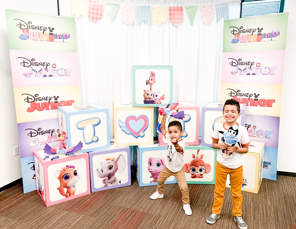 Princeton and Skyler of Sweet P and Sky, posing in front of the T.O.T.S. display at the Disney Junior Party in Burbank California