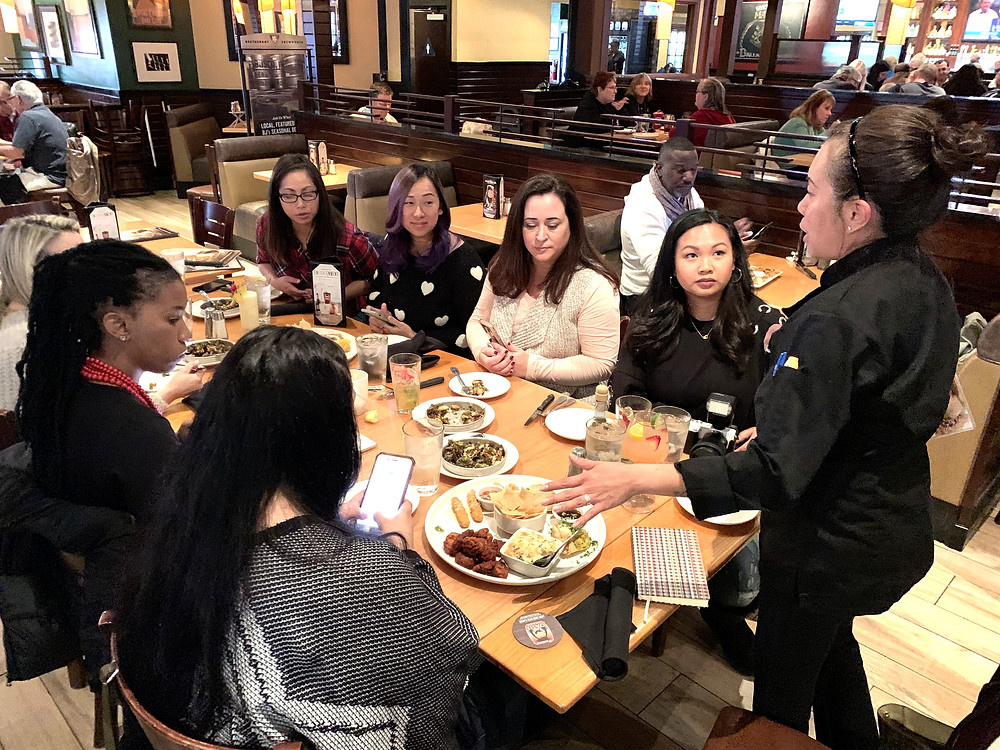Leanne explaining the BJ's Restaurant & Brewhouse menu to LA Mommy Blogger Tribe