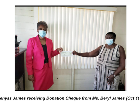 Correspondence: Communities Arise receiving Donation check from GUYDA