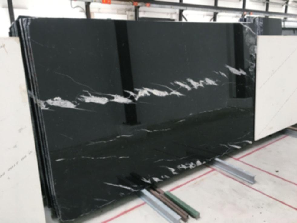 Pizzul - Nero Markina marble slabs.jpeg