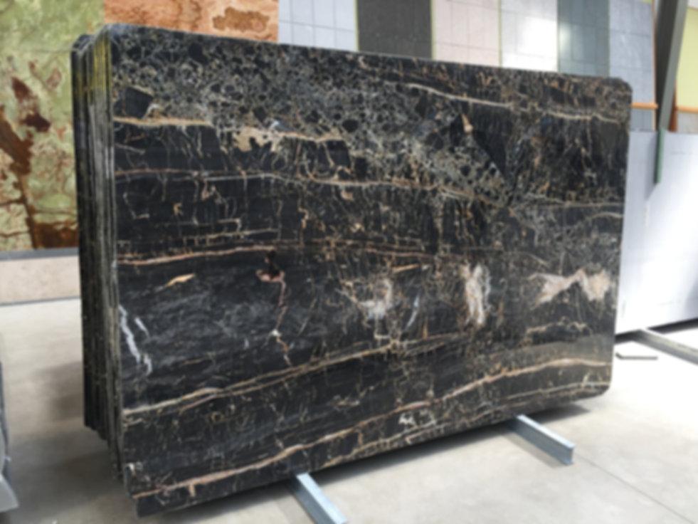 Pizzul - Portoro marble slabs.jpeg