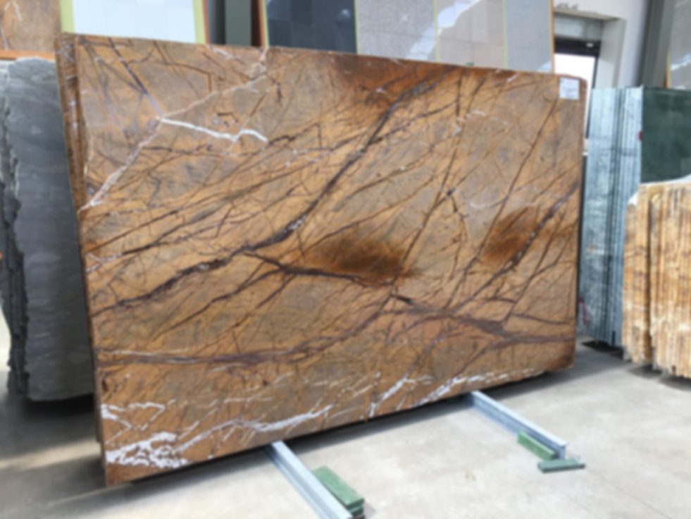 Pizzul - Rainforest Gold marble slabs.jp