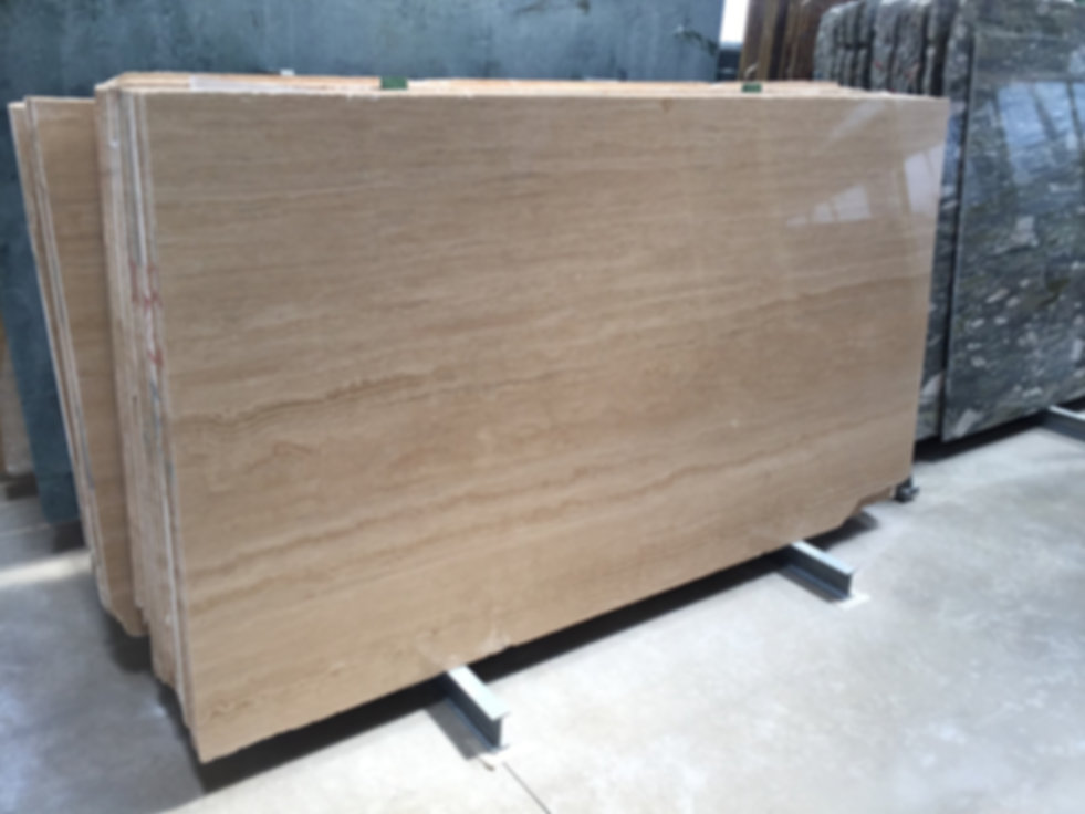 Pizzul - Travertino Wooden marble slabs.