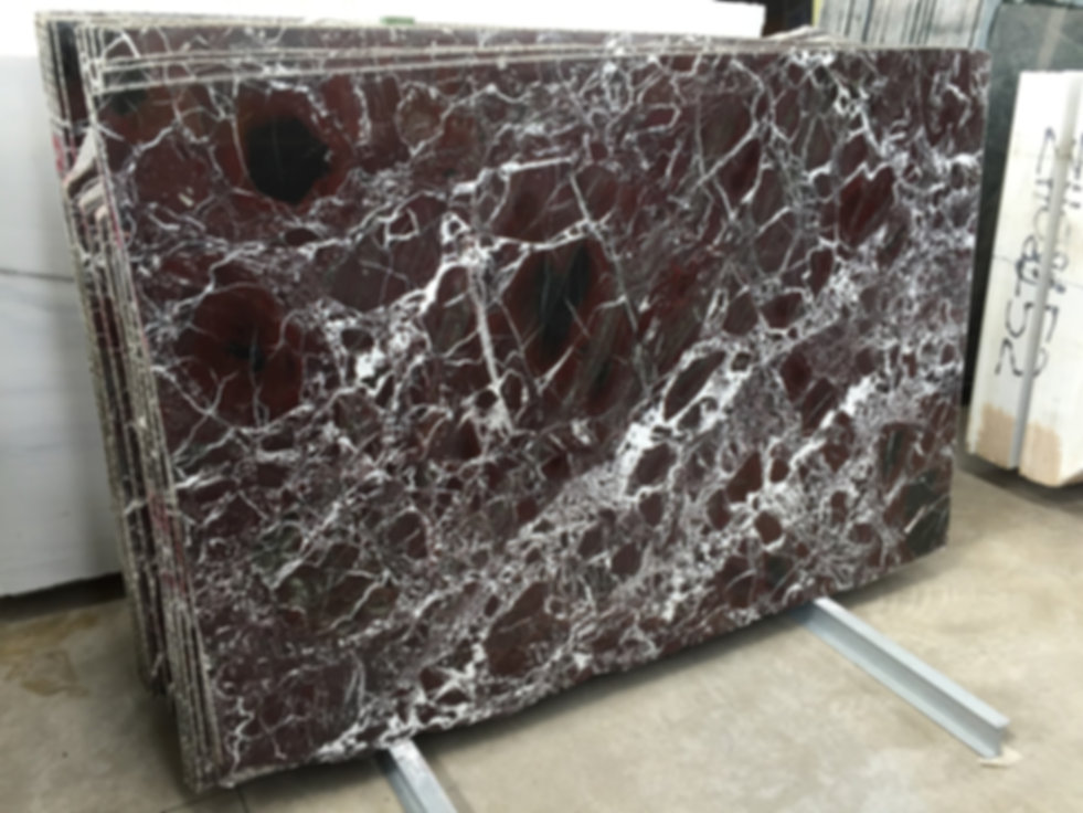 Pizzul - Rosso Levanto marble slabs.jpeg