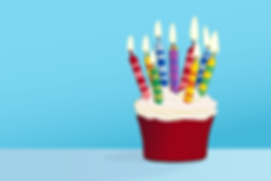 Birthday-cupcake-against-a-blu-71570377.