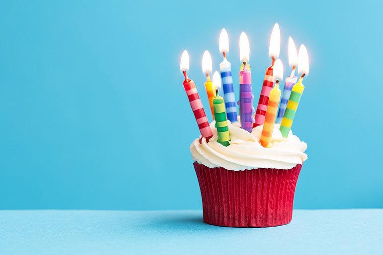Birthday-cupcake-against-a-blu-71570377.
