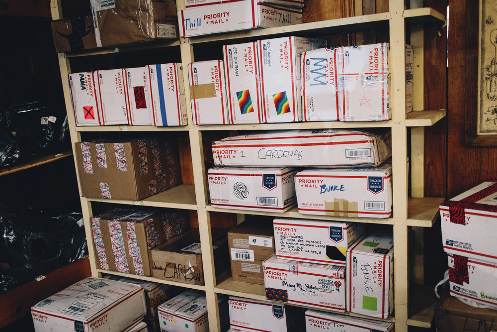 resupply boxes on a shelf at the post office.