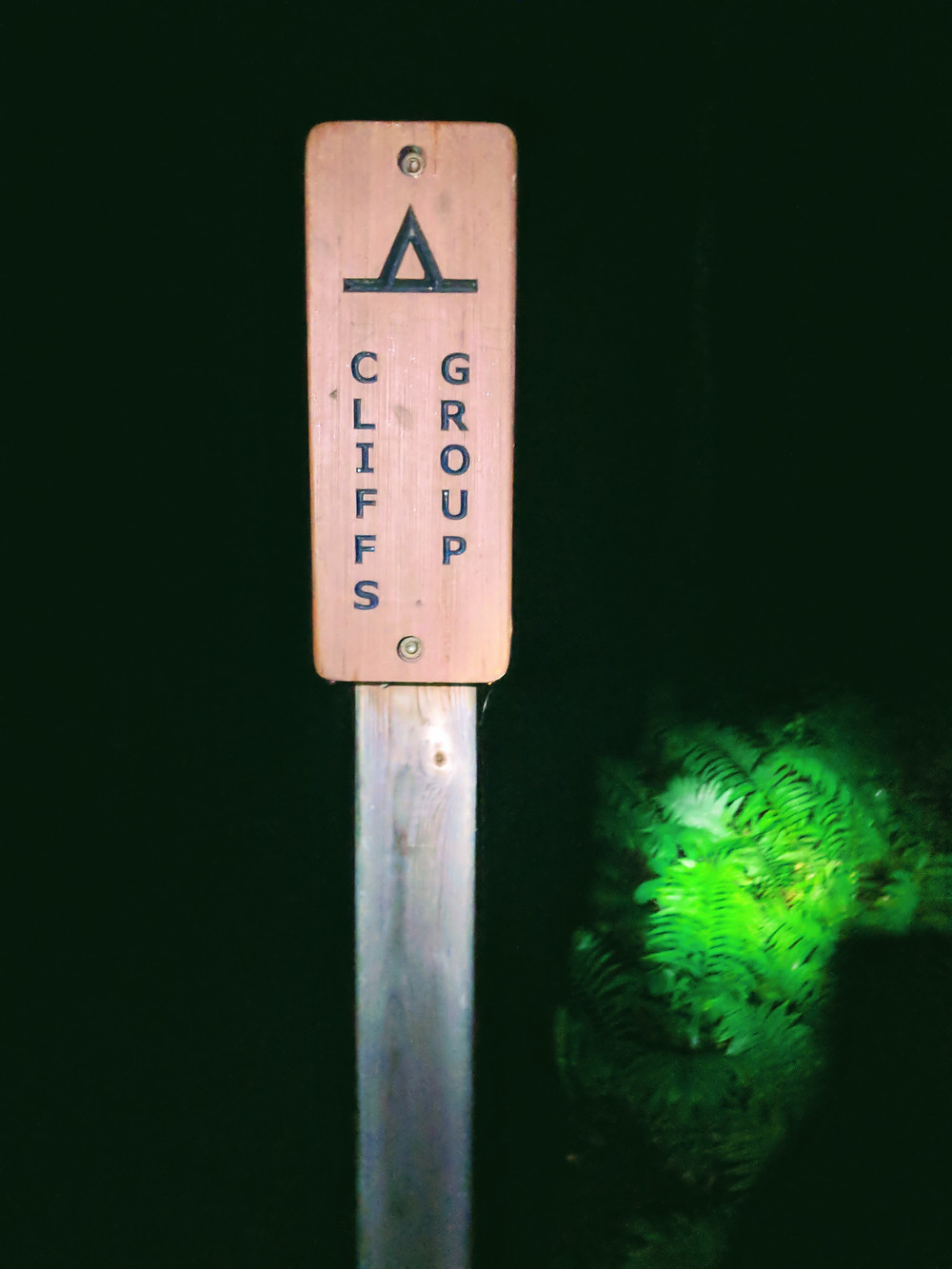 Cliffs Group campsite sign, illuminated by headlamp