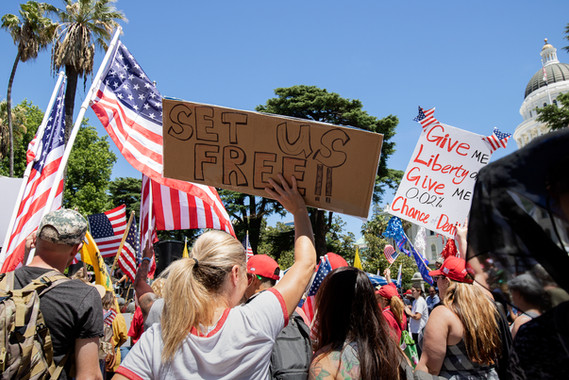 """Thousands of Californians kick off Memorial Day weekend with a rally known as """"Liberty Fest"""" in front of the Capitol on May 23rd, 2020. The protesters were extremely diverse, coming from all different races and ages. Liberty Fest had several keynote speakers speaking throughout the event, including Ben Bergquam, Eric Early, KrisAnn Hall, and many more. Local hairstylist also set up their booths and offered haircuts all day."""