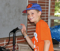 Male camper holding microphone