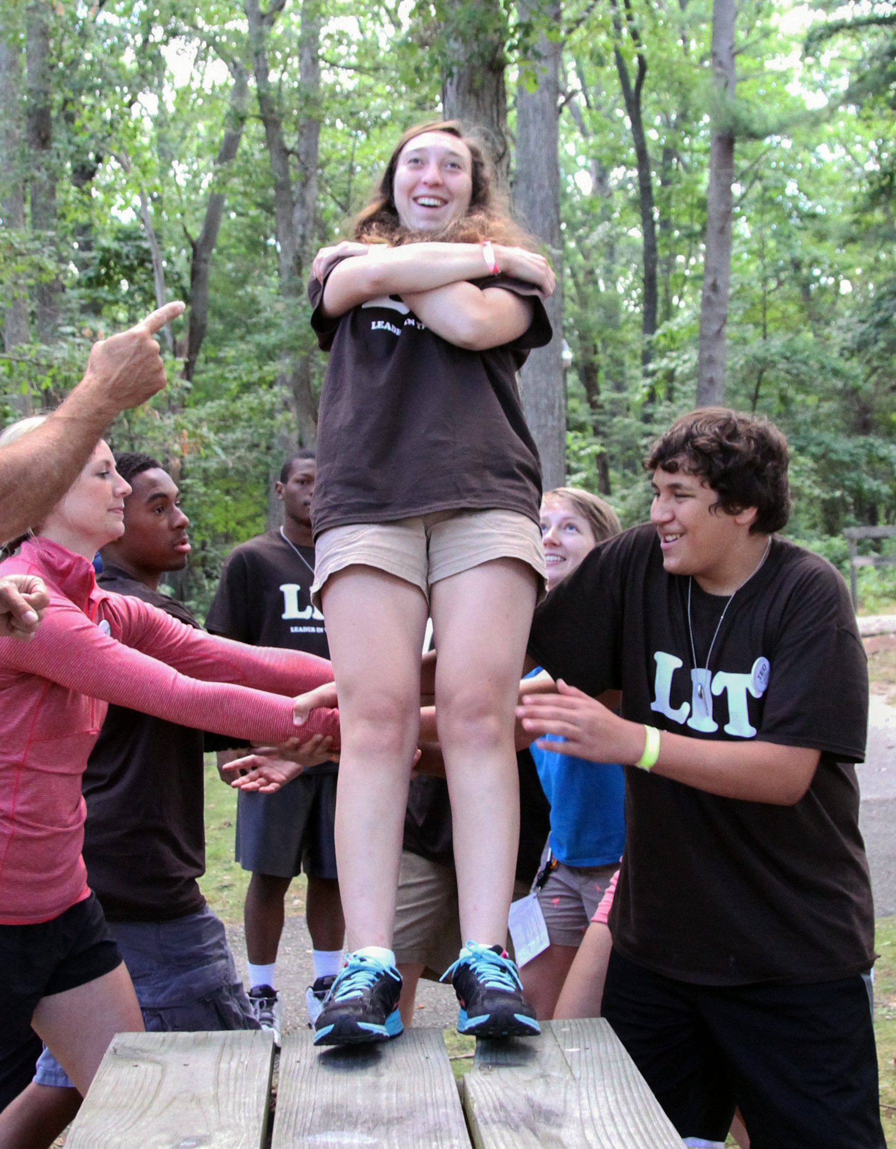 Campers practicing a trust fall