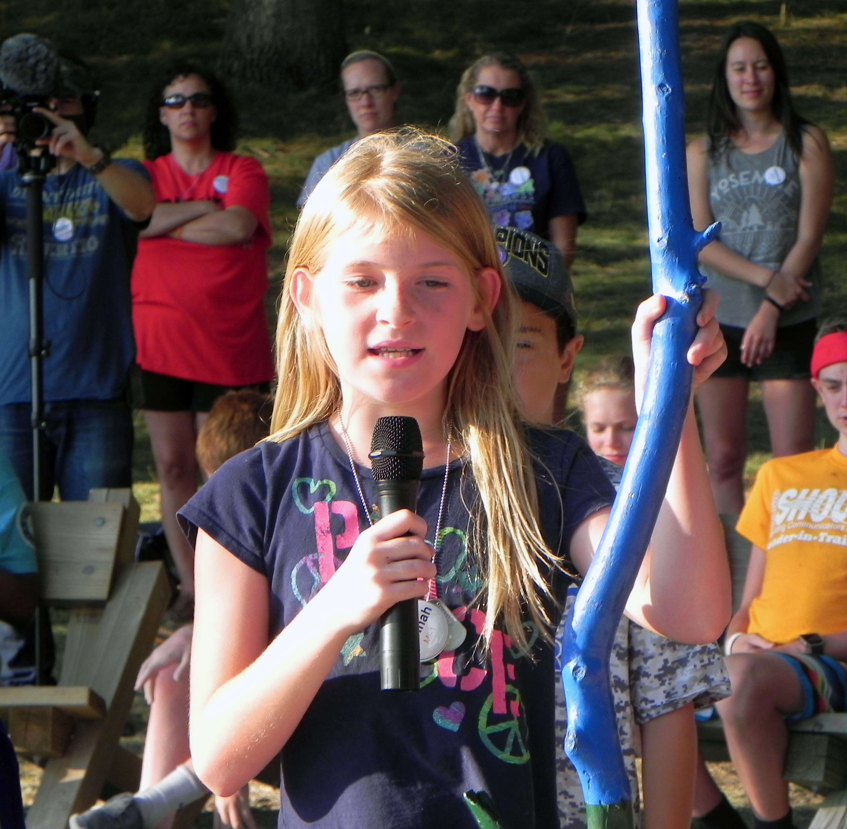 Female camper talking into microphone