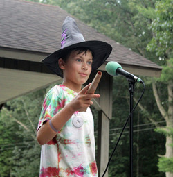 Boy in wizard hat on stage
