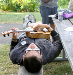 Camp counselor playing the ukelele