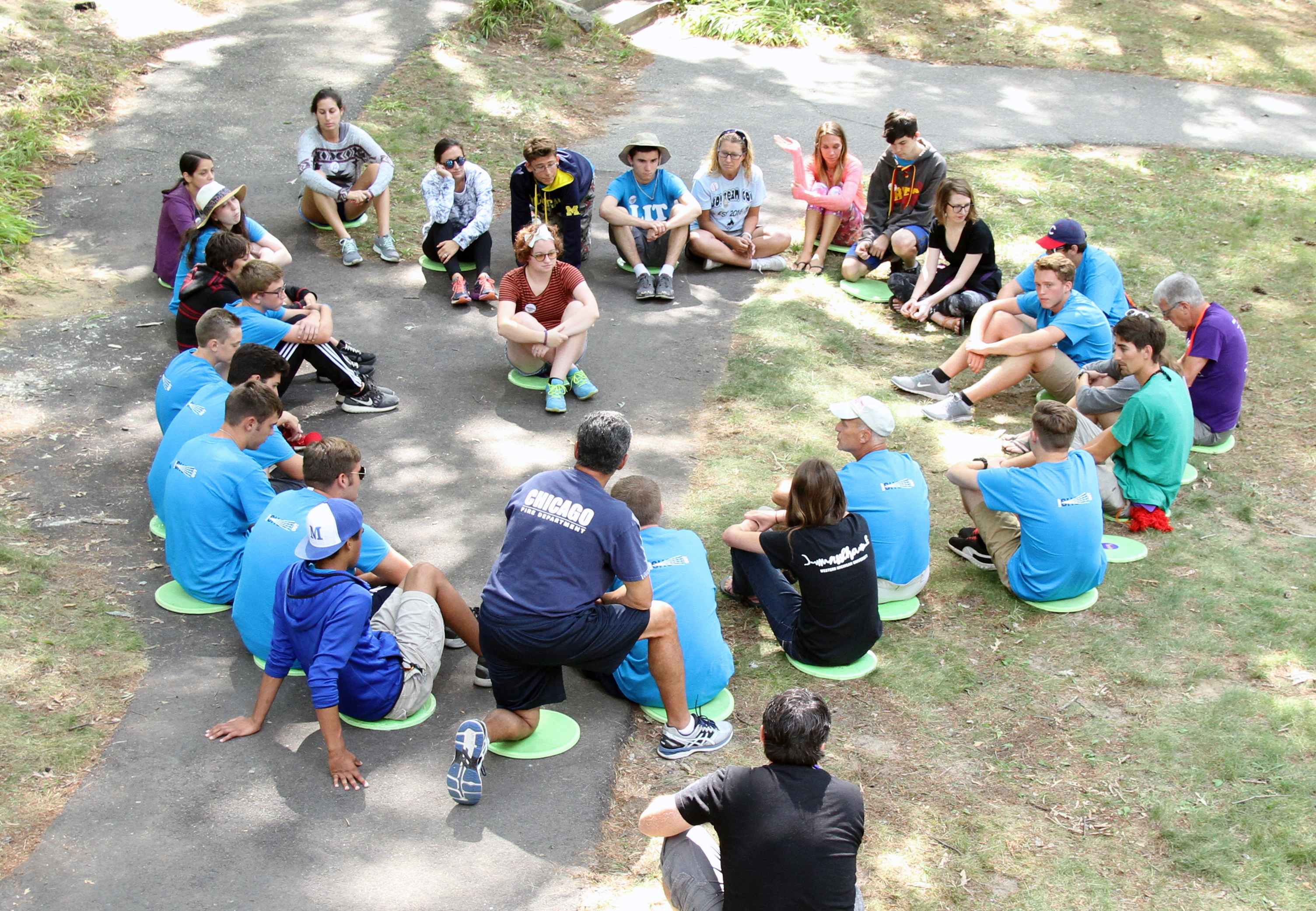 Group of people sitting in a circle