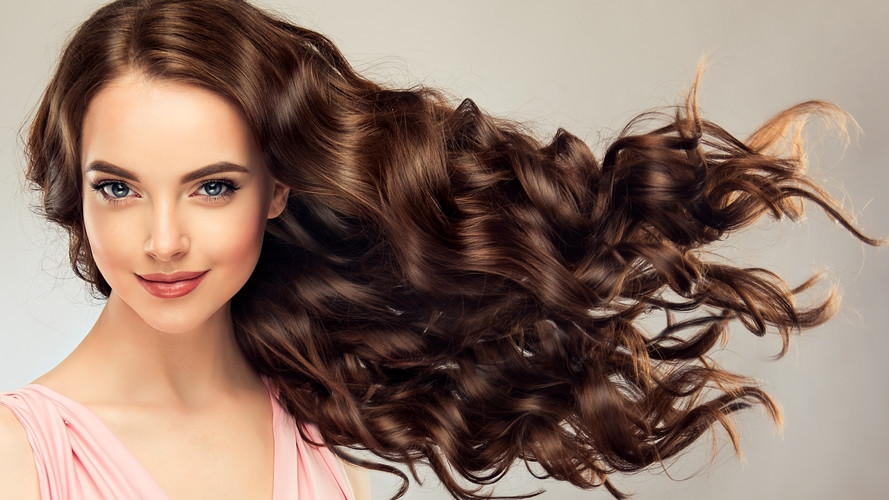 Brunette  girl with long , healthy and