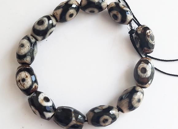 String of 13 Faceted Cut Dzi Style Beads