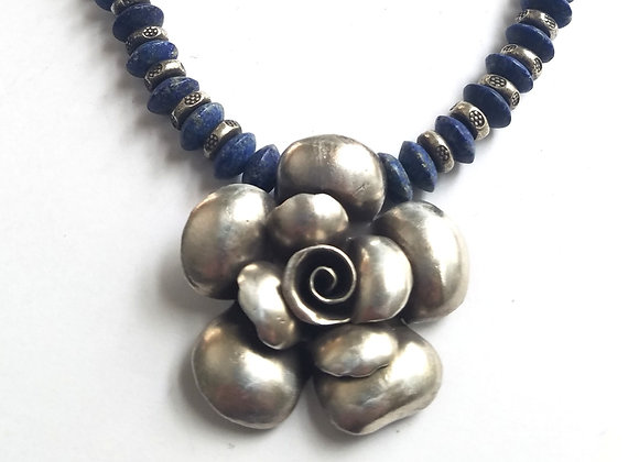 Hill Tribe Silver Flower with smooth Lapis beads.