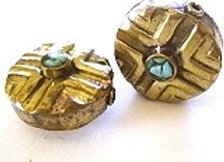 Brass bead with turquoise middle