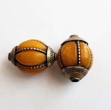 Tibetan Amber Bead with brass rope caps