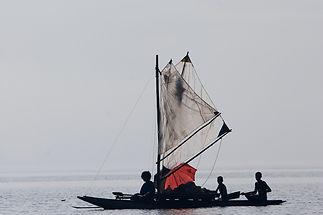 Villagers in Canoe, Tufi Resort, Papua New Guinea