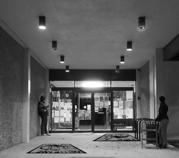 library back entrance with portraits el