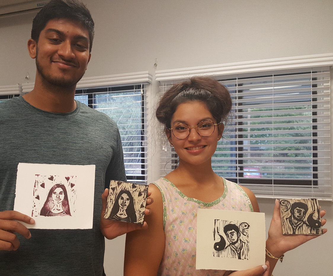 Community participants with their portraits of each other