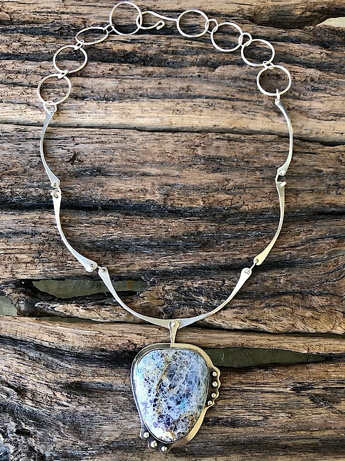 Kaleidoscope Stone Necklace with a forged sterling silver chain.