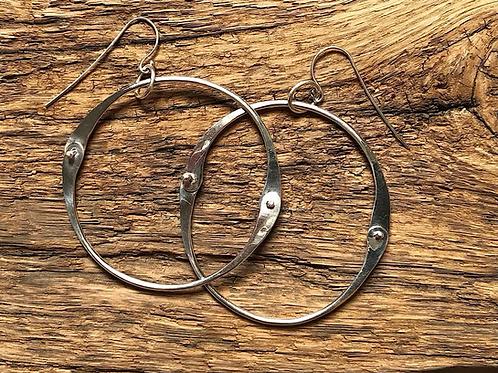 Mid Century Modern style sterling silver hoop earrings.