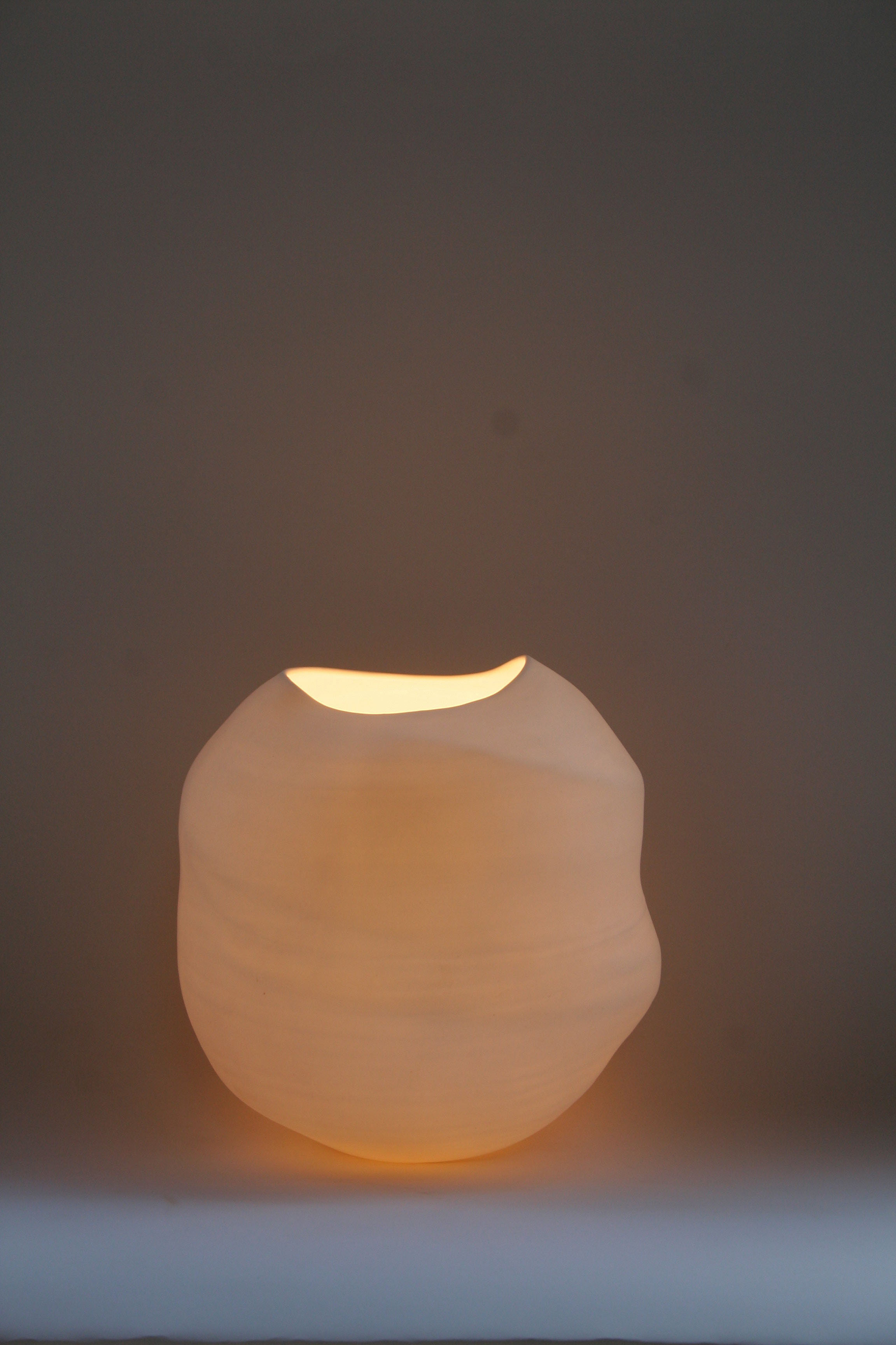 8. Cast Free standing Moon Bowl.