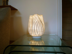 Freestanding light sculpture. Thrown porcelain, reformed and fluted. Private Collection