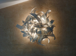 Wall light sculpture, thrown and joined porcelain ribbons. Private Collection