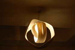 Circles, thrown porcelain pendant light sculpture. Private Collection
