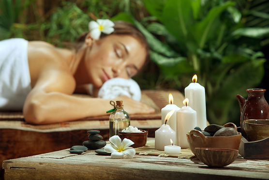 Woman Relaxing in Serene Massage Spa