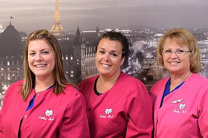 Dental Assistants Caitlin, Traci, and Paula