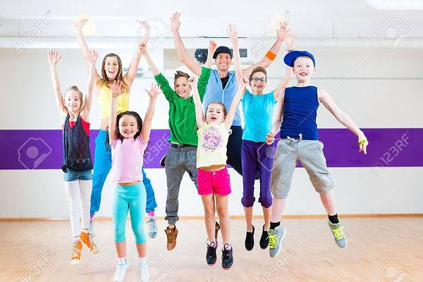 33782944-dance-teacher-giving-children-fitness-class-in-gym.jpg