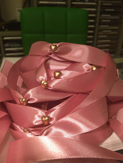 Pink ribbons decorated with gold mini hearts