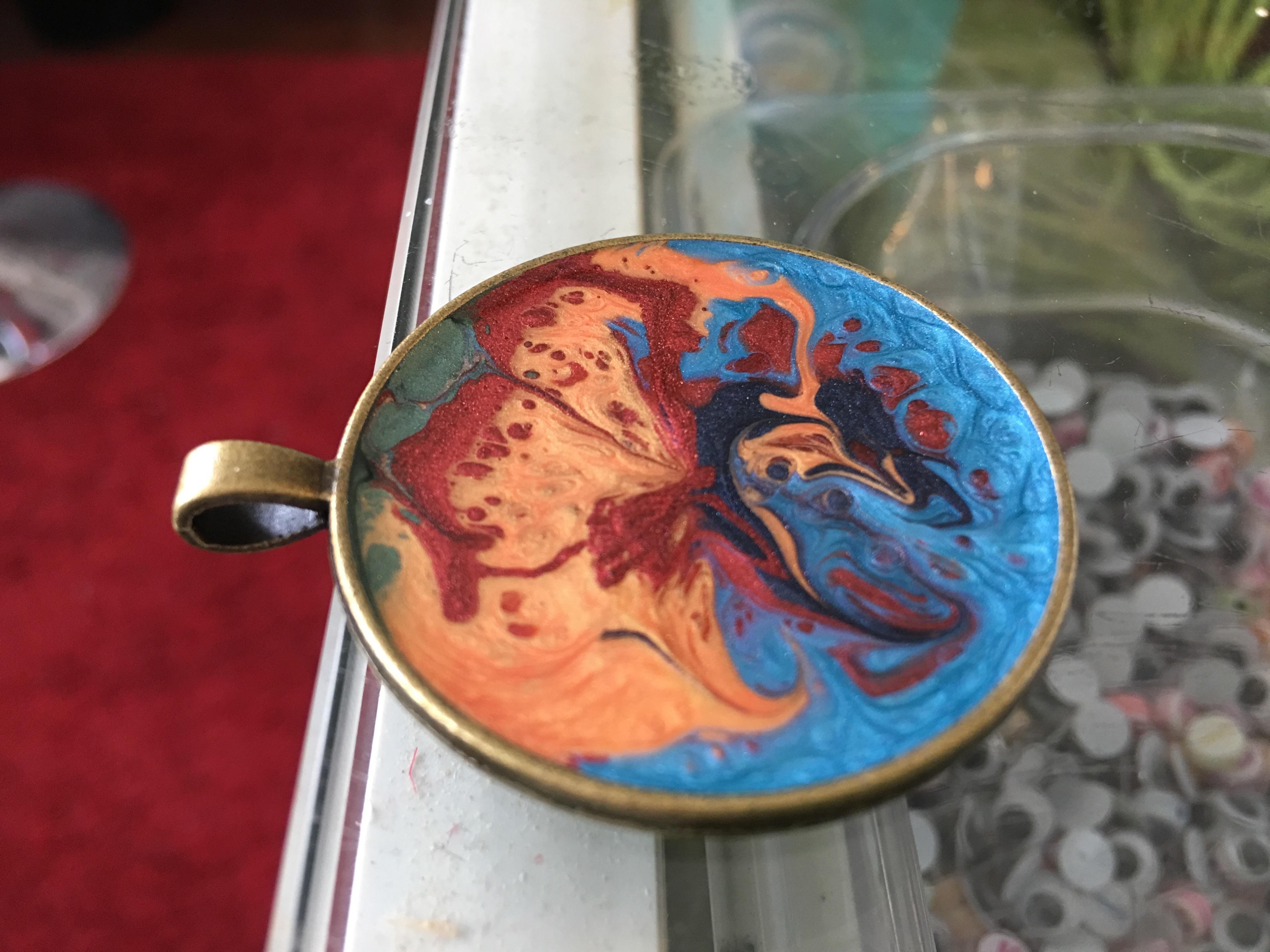 Antique bronze pendant