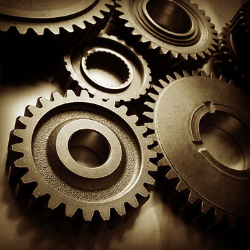 Metal cog wheels bonding together.jpg