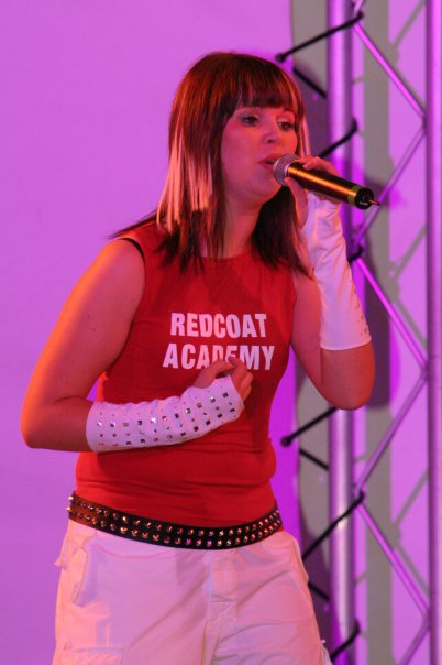hollie red coat singing
