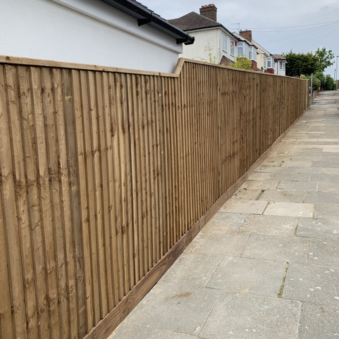 Feather edge Fence with Top Capping