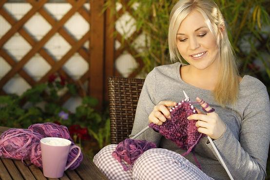 Woman knitting on terrace.jpg