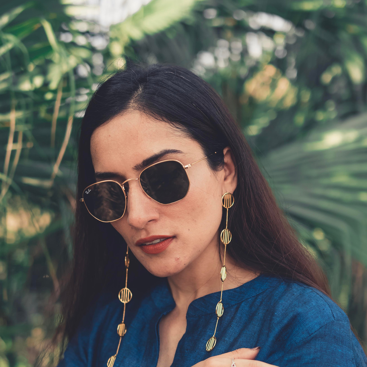 Urmi Daga of the blog What Wear How in our shoulder dusters