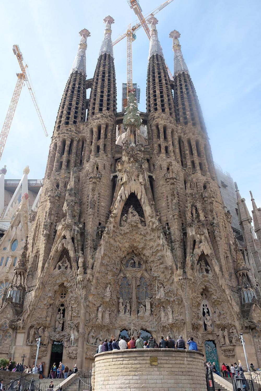 Soaring cranes over Sagrada Familia